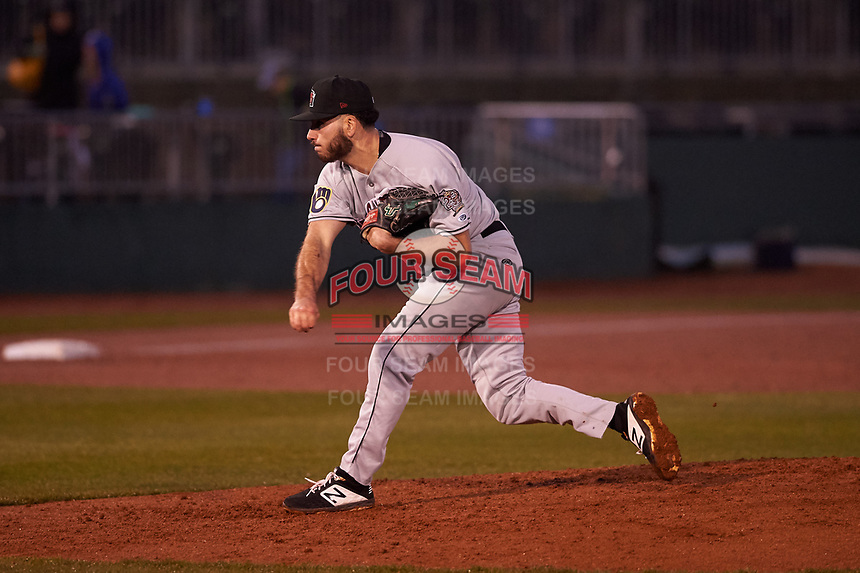 Wisconsin Timber Rattlers relief pitcher Peter Strzelecki (24) during a Midwest League game against the Lansing Lugnuts at Cooley Law School Stadium on May 2, 2019 in Lansing, Michigan. Lansing defeated Wisconsin 10-4. (Zachary Lucy/Four Seam Images)