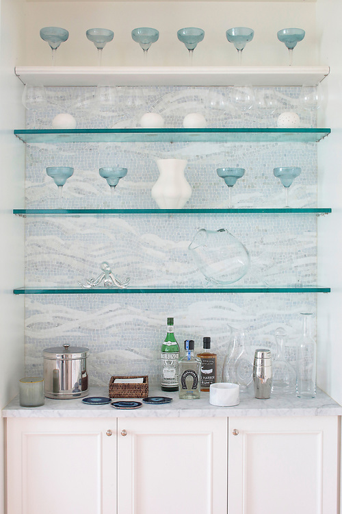 Our Clouds stone mosaic is the highlight of this niche dry bar in a contemporary East Hamptons home.<br /> <br /> Interior design by Mabley Handler: www.mableyhandler.com/<br /> <br /> Photography by Eric Striffler: www. striffler.com