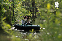 Teenagers rowing in a rowboat on river (Licence this image exclusively with Getty: http://www.gettyimages.com/detail/83154154 )