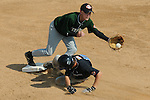 Aberdeen, MD: Brandt Burrows of Tampa slides into second as Alec Cook of Willamette Valley moves towards the ball during Thursday afternoon's game at the 2009 Cal Ripken World Series.