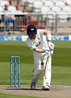 27th May 2021; Emirates Old Trafford, Manchester, Lancashire, England; County Championship Cricket, Lancashire versus Yorkshire, Day 1; Dom Bessof Yorkshire plays a straight drive down the wicket off Saqib Mahmood of Lancashire