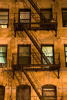 AVAILABLE FROM JEFF AS A FINE ART PRINT.<br /> <br /> AVAILABLE FROM PLAINPICTURE FOR COMMERCIAL AND EDITORIAL LICENSING.  Please go to www.plainpicture.com and search for image # p5690180.<br /> <br /> Upward View of Tenement on Manhattan's Lower East Side at Night with Illuminated Windows, New York City, New York State, USA