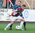 Stenny's Gary Oliver holds off Forfar's Mark Baxter.