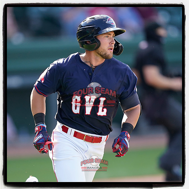 Second baseman Cam Cannon (4) of the Greenville Drive watches the flight of his home run as he rounds the bases in a game against the Bowling Green Hot Rods on Thursday, May 6, 2021, at Fluor Field at the West End in Greenville, South Carolina. (Tom Priddy/Four Seam Images)