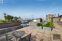 BNPS.co.uk (01202) 558833. <br /> Pic: OrlandoReid/BNPS<br /> <br /> Pictured: Rooftop garden. <br /> <br /> A flat in a ten-storey Art Deco mansion block that was the fictional home of TV detective Hercule Poirot has gone up for rent for £1,950 a month.<br /> <br /> Grade II listed Florin Court in East London was used for filming the long-running ITV series about Agatha Christie's iconic detective.<br /> <br /> The one-bedroom ground floor flat includes a double bedroom, an open plan reception room and kitchen, and a study or home office and<br /> a marble-tiled family bathroom.<br /> <br /> The exterior of the building has strong Art Deco motifs, many of which were used in the filming of Poirot, for 24 years, from 1989 to 2013.