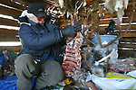 Vuntut Gwitchin First Nation hunter, Stanley Njootli Sr., sits in his meat cache in Old Crow, Yukon Territory, Canada.