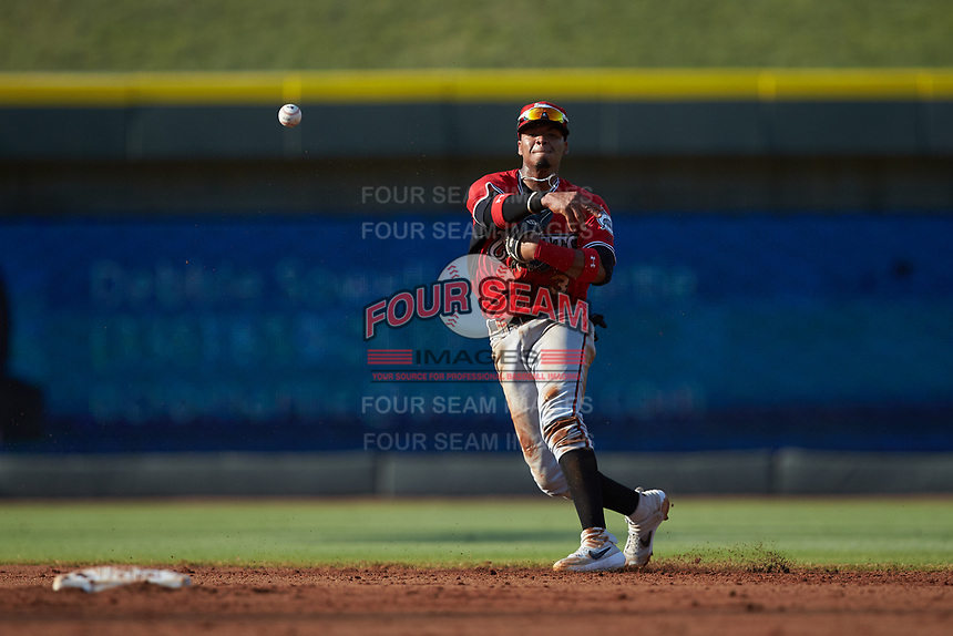 Carolina Mudcats shortstop Julio Garcia (3) makes a throw to first base against the Winston-Salem Dash at BB&T Ballpark on June 1, 2019 in Winston-Salem, North Carolina. The Mudcats defeated the Dash 6-3 in game one of a double header. (Brian Westerholt/Four Seam Images)