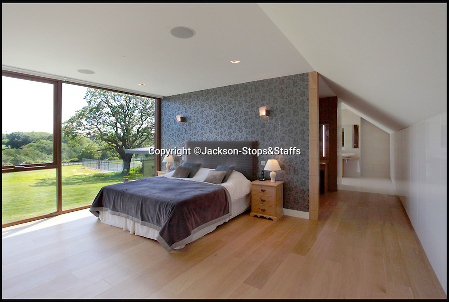 BNPS.co.uk (01202 558833)<br /> Pic: Jackson-Stops&Staff/BNPS<br /> <br /> Stunning bedroom in the main house...<br /> <br /> For sale - Super home with its own leisure centre attached.<br /> <br /> The buyers of this stunning country property will never need to leave home again - with their own leisure complex at their fingertips.<br /> <br /> Birchwood House in Hoar Cross, Staffs, is a bespoke five-bedroom house that makes the most of the incredible countryside surrounding it with floor to ceiling windows in most rooms.<br /> <br /> But the really unusual selling feature is its unsurpassed leisure suite with a purpose-built gym, 15-metre swimming pool, sauna and steam room. <br /> <br /> It might save you a fortune in gym fees, but any wannabe owners will need £2.75million to get their hands on this cutting edge, contemporary pad.<br /> <br /> The house also has a media room which currently has a pool table and a home cinema, meaning you really could settle in for the long haul.