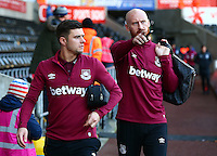Aaron Cresswell and James Collins of West Ham United arrive before the Barclays Premier League match between Swansea City and West Ham United played at The Liberty Stadium, Swansea on 20th December 2015