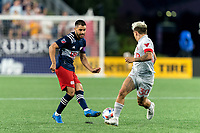 FOXBOROUGH, MA - JULY 7: Carles Gil #22 of New England Revolution passes the ball during a game between Toronto FC and New England Revolution at Gillette Stadium on July 7, 2021 in Foxborough, Massachusetts.
