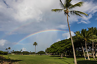 Towards sunset, a second rainbow begins to appear over another at Hale'iwa Ali'i Beach Park, North Shore, O'ahu