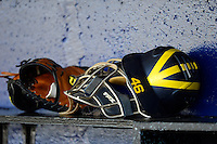 Michigan Wolverines catchers equipment on the bench before an exhibition game against the New York Mets at Tradition Field on February 24, 2013 in St. Lucie, Florida.  New York defeated Michigan 5-2.  (Mike Janes/Four Seam Images)