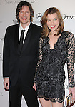 """Milla Jovovich and Paul W.S. Anderson attends the Art of Elysium 4th Annual Charity Gala """"Heaven"""" held at The Annenberg Building at The California Science Center in Los Angeles, California on January 15,2011                                                                               © 2010 DVS / Hollywood Press Agency"""