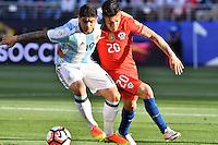 Argentina midfielder Evar Banega (19) and Chile midfielder Charles Aranguiz (20) battle for the ball during Copa America Centenario group D match, in Santa Clara, CA. Monday, Jun 06, 2016. Argentina won 2-1.(TFV Media via AP) *Mandatory Credit*