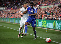 (L-R) Gylfi Sigurdsson of Swansea challenges John Obi Mikel of Chelsea during the Barclays Premier League match between Swansea City and Chelsea at the Liberty Stadium, Swansea on April 9th 2016