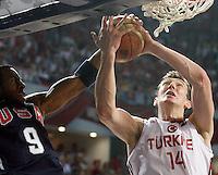 Andre IGUODALA (USA) blocks Omer ASIK (Turkey) during the Final World championship basketball match against Turkey in Istanbul, Turkey-USA, Turkey on Sunday, Sep. 12, 2010. (Novak Djurovic/Starsportphoto.com) .