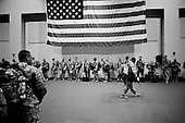 Columbus, Georgia.USA.March 12, 2007..450 soldiers of the third Infantry, third brigade are deployed to Iraq from Fort Benning, Georgia. Many of the men are being deployed for their second or third tour of duty...After separating from their families soldiers spent their last few hours in a hanger at the airport waiting for the plane to fly them into Iraq...Once the plane arrives they are called out one by one and board the aircraft.