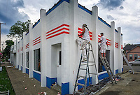 Painters complete the new design at Westerville Automotive in Uptown Westerville.