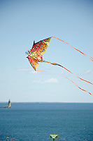 Maine lighthouse with flying dragon kite in Fort Williams park Maine