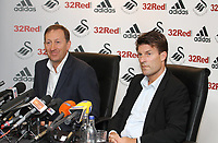 Michael Laudrup is official unveiled as the new manager of Swansea City FC in a press conference at the Liberty Stadium, today, 21/06/12<br /> Pictured: Chairman Huw Jenkins left and Michael Laudrup right<br /> Picture by: Ben Wyeth / Athena Picture Agency