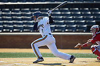 Brian Moskey (7) of the Quinnipiac Bobcats follows through on his swing against the Radford Highlanders at David F. Couch Ballpark on March 4, 2017 in Winston-Salem, North Carolina. The Highlanders defeated the Bobcats 4-0. (Brian Westerholt/Four Seam Images)