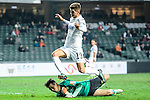 Auckland City Defender Alfie Rogers (r) attempts a kick while being defended by SC Kitchee Goalkeeper Jianqiao Guo (l) during the Nike Lunar New Year Cup 2017 match between SC Kitchee (HKG) and Auckland City FC (NZL) on January 31, 2017 in Hong Kong, Hong Kong. Photo by Marcio Rodrigo Machado / Power Sport Images