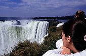 Iguacu Falls. Tourist looking at the waterfalls from a viewpoint on the Argentinian side.