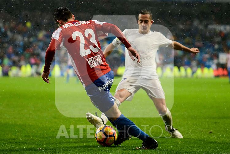 Real Madrid's player Lucas Vazquez and Sporting de Gijon's player Moi Gonzalez during match of La Liga between Real Madrid and Sporting de Gijon at Santiago Bernabeu Stadium in Madrid, Spain. November 26, 2016. (ALTERPHOTOS/BorjaB.Hojas)