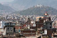 Nepal, Kathmandu.  Swayambhunath Temple from Kathmandu Durbar Square, February 19, 2009.  The white brick chedi on the left fell during the April 2015 earthquake.