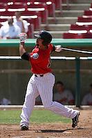 Mickey Wiswall #15 of the High Desert Mavericks bats against the Visalia Rawhide at Stater Bros. Stadium on May 16, 2012 in Adelanto,California. (Larry Goren/Four Seam Images)