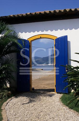 Paraty, Rio de Janeiro, Brazil. View through blue gates to the sea.