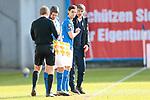 20.02.2021, xtgx, Fussball 3. Liga, FC Hansa Rostock - SV Waldhof Mannheim, v.l. Tobias Schwede (Rostock), Jens Haertel (Hansa Rostock, Trainer) <br /> <br /> (DFL/DFB REGULATIONS PROHIBIT ANY USE OF PHOTOGRAPHS as IMAGE SEQUENCES and/or QUASI-VIDEO)<br /> <br /> Foto © PIX-Sportfotos *** Foto ist honorarpflichtig! *** Auf Anfrage in hoeherer Qualitaet/Aufloesung. Belegexemplar erbeten. Veroeffentlichung ausschliesslich fuer journalistisch-publizistische Zwecke. For editorial use only.