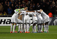 Swansea, UK. Thursday 20 February 2014<br /> Pictured: Swansea players huddle before kick off<br /> Re: UEFA Europa League, Swansea City FC v SSC Napoli at the Liberty Stadium, south Wales, UK