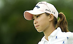 SINGAPORE - MARCH 07:  Momoko Ueda of Japan waits on the par tree 11th hole during the third round of HSBC Women's Champions at the Tanah Merah Country Club on March 7, 2009 in Singapore. Photo by Victor Fraile / The Power of Sport Images