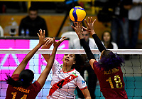 BOGOTÁ-COLOMBIA, 09-01-2020: Aleoscar Blanco y Alejandra Arguello de Venezuela, intentan un bloqueo al ataque de balón a Maricarmen Guerrero de Perú, durante partido entre Perú y Venezuela, en el Preolímpico Suramericano de Voleibol, clasificatorio a los Juegos Olímpicos Tokio 2020, jugado en el Coliseo del Salitre en la ciudad de Bogotá del 7 al 9 de enero de 2020. / Aleoscar Blanco and Alejandra Arguello from Venezuela, tries to block the attack the ball to Maricarmen Guerrero from Peru, during a match between Perú and Venezuela in the South American Volleyball Pre-Olympic Championship, qualifier for the Tokyo 2020 Olympic Games, played in the Colosseum El Salitre in Bogota city, from January 7 to 9, 2020. Photo: VizzorImage / Luis Ramírez / Staff.