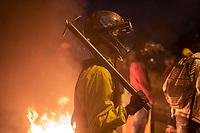 BOGOTA - COLOMBIA, 25-05-2021: Un manifestante de primera línea porta un bate de metal durante los disturbios en el sector de las Américas de la ciudad de Bogotá durante el día 28 del Paro Nacional en Colombia hoy, 25 de mayo de 2021, para protestar contra el gobierno de Ivan Duque además de la precaria situación social y económica que vive Colombia. El paro fue convocado por sindicatos, organizaciones sociales, estudiantes y la oposición. / A frontline protester carries a metal bat during the riots at Portal Las Americas sector of the city of Bogota during the day 28 of the National strike in Colombia today, May 25, 2021, to protest against the government of Ivan Duque in addition to the precarious social and economic situation that Colombia is experiencing. The strike was called by unions, social organizations, students and the opposition in Colombia. Photo: VizzorImage / Diego Cuevas / Cont