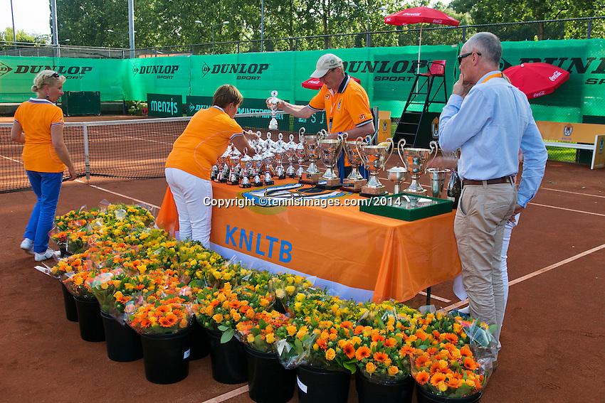 August 9, 2014, Netherlands, Rotterdam, TV Victoria, Tennis, National Junior Championships, NJK,  Preparing the trophy table<br /> Photo: Tennisimages/Henk Koster