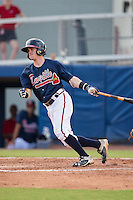 Marcus Mooney (14) of the Danville Braves follows through on his swing against the Pulaski Yankees at American Legion Post 325 Field on July 31, 2016 in Danville, Virginia.  The Yankees defeated the Braves 8-3.  (Brian Westerholt/Four Seam Images)