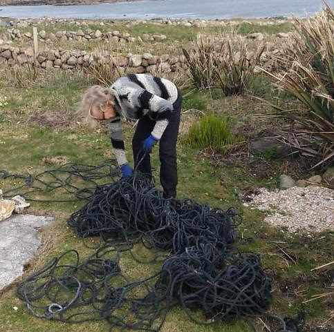 "Hanneke Frenkel collecting ""sea rope"" to make carpets last year on Turbot island"