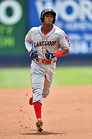 Lakewood BlueClaws Malvin Matos (33) rounds the bases after hitting a home run during a game against the Asheville Tourists at McCormick Field on August 4, 2019 in Asheville, North Carolina. The Tourists defeated the BlueClaws 13-6. (Tony Farlow/Four Seam Images)