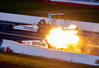 Sep 5, 2020; Clermont, Indiana, United States; NHRA top fuel driver T.J. Zizzo explodes an engine on fire alongside Justin Ashley during the delayed final round of the Summer Nationals during qualifying for the US Nationals at Lucas Oil Raceway. Mandatory Credit: Mark J. Rebilas-USA TODAY Sports