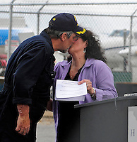 17 April 2009: Captain Richard Phillips kisses his wife Andrea after returning to the United States, and an 18-hour journey home from Mombasa, Kenya, arriving at the Burlington International Airport, in Burlington, Vermont, USA 17 April 2009. Captain Phillips was held hostage for five days by Somali pirates in an attempted hijacking of the Maersk cargo ship Alabama. United States Navy Seal sharpshooters on the USS Bainbridge killed three pirates to free Captain Phillips in his dramatic rescue.
