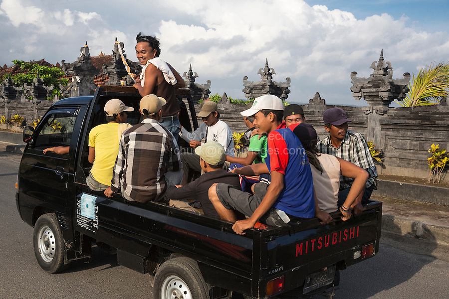 Bali, Indonesia.  Road Safety.  Men Riding in an Open Pick-up Truck, no Helmets, no Seat Belts.