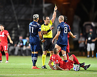 LAKE BUENA VISTA, FL - JULY 26: Referee Alex Chillowicz shows a yellow card to Alexander Ring of New York City FC as Valentín Castellanos of New York City FC during a game between New York City FC and Toronto FC at ESPN Wide World of Sports on July 26, 2020 in Lake Buena Vista, Florida.