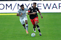 WASHINGTON, DC - NOVEMBER 8: Donovan Pines #23 of D.C. United battles for the ball with Anthony Jackson-Hamel #11 of Montreal Impact during a game between Montreal Impact and D.C. United at Audi Field on November 8, 2020 in Washington, DC.
