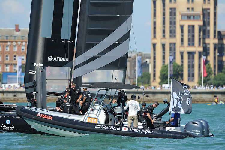 SoftBank Team Japan, JULY 23, 2016 - Sailing: SoftBank Team Japan with the support boat after race two during day one of the Louis Vuitton America's Cup World Series racing, Portsmouth, United Kingdom. (Photo by Rob Munro/Stewart Communications)