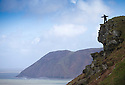 07/04/16 <br /> <br /> A woman braces herself against gale force winds as she stands on top of cliffs on the Valley of Rocks which rise some 500 ft above the shoreline near Linton, North Devon.<br /> <br /> All Rights Reserved: F Stop Press Ltd. +44(0)1335 418365   +44 (0)7765 242650 www.fstoppress.com