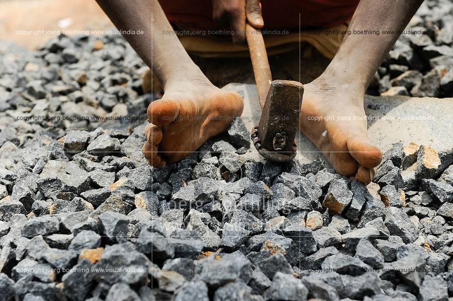 SIERRA LEONE, Freetown, woman works in quarry, smashing granite stones