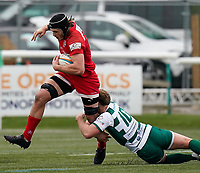 Kyle Hatherell of Jersey Reds is tackled by Craig Willis of Ealing Trailfinders during the Championship Cup QF match between Ealing Trailfinders and Jersey Reds at Castle Bar, West Ealing, England  on 22 February 2020. Photo by David Horn.