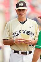 Wake Forest Demon Deacons head coach Tom Walter #32 delivers the lineup card to home plate prior to the game against the North Carolina State Wolfpack at Doak Field at Dail Park on March 17, 2012 in Raleigh, North Carolina.  The Wolfpack defeated the Demon Deacons 6-2.  (Brian Westerholt/Four Seam Images)